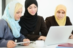 Muslim women working on a computer